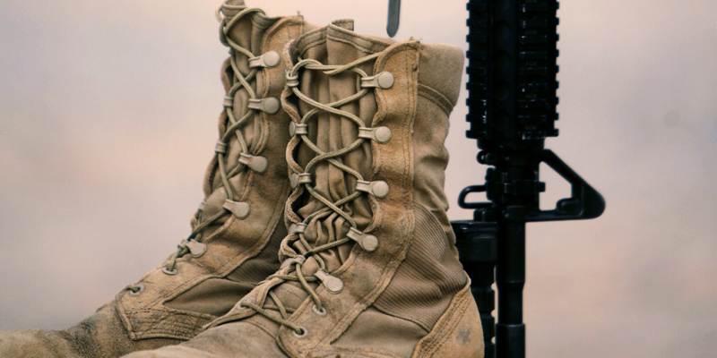 The boots, gun, helmet and dog-tags of U